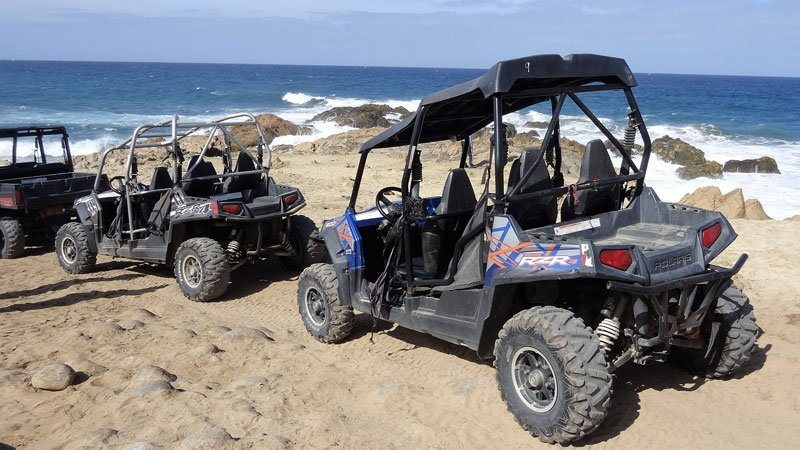 Polaris RZRs by the ocean