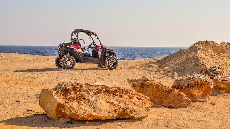 UTV SxS near ocean rocks