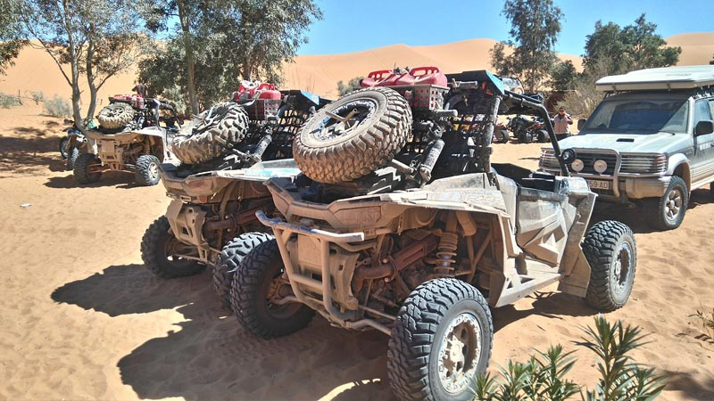 Polaris RZRs in the desert sand